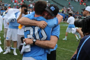 Coach Joe Breschi hugs his goalie Brian Balkum after winning the national championship